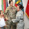Maj Andrea C. Acosta received a Meritorious Service Medal May 25,2016, inside the command suite at McGinnis-Wickam Hall as coworkers and friends looked on. (Photo by Markeith Horace, MCoE PAO Photographer)