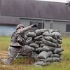 A Best Warrior Competitor throws a grenade as part of the Urban Operations event at McKenna Mout Site Aug. 1, 2012 at Fort Benning, Ga. Events were designed to reflect a realistic combat environment where the soldier was required to throw grenades accurately while engaging various targets from three different positions at ranges from 10-30 meters, clear buildings and assess a casualty using a litter and call a 9 line Medical Evacuation. (US Army Photo by Ashley Cross)