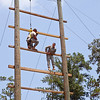 Sgt. 1st Class Vanessa Urban works to move up the Confidence Climb on the Warrior Training Center Obstacle Course, Aug. 1, 2012 at Fort Benning, Ga. Soldiers were tested in various mental and physical areas such as Land Navigation, Essay Writing, a foot march, and a final culminating 'mystery event' that involved assembly of four weapons, identifying IEDs, rappelling down a 64-foot tower and dragging a litter over a 12-foot wall. (US Army Photo by Taffy Steinborne-Keller)