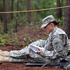 Sgt. 1st Class Vanessa Urban, Massachusettes National Guard, reads through literature during downtime at the Best Warrior Competition Aug. 1, 2012  at Fort Benning, Ga. Urban's long term goals are to acheive the rank of Master Sergeant and to earn a master's degree and Health and Education. Essay writing and a written exam are also part of the competition. (US Army Photo by Ashley Cross)