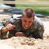 National Guard NCO of the Year, Sgt. Matthew Howard, Arkansas National Guard, low crawls through sand at the Warrior Training Center's Obstacle Course Aug. 1, 2012 at Fort Benning, Ga. Howard has served in the Army for almost 18 years and has deployed in support of Operation Iraqi Freedom and Operation Noble Eagle. (US Army Photo by Taffy Steinborne-Keller)