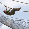 Soldiers competing in the Best Warrior Competition made their way through the Warrior Training Center's Obstacle Course, Aug. 1, 2012 at Fort Benning, Ga. The Georgia heat made the competition tough with temperatures reaching 90 plus degrees. (US Army Photo by Taffy Steinborne-Keller)