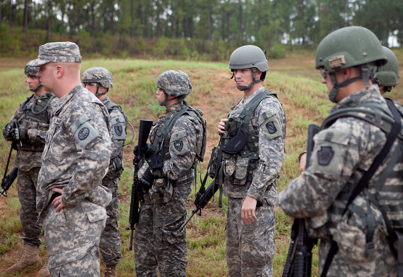 Fort Benning, Ga., - Soldiers wait for instruction before the Stress Shoot portion of the Best Warrior Competition July 31, 2012 at Fort Benning, Ga. The competitors were required to maneuver various obstacles between assembling and shooting the M16 Assault Rifle, 9 mm Pistol, M240B Machine Gun, M249 Machine Gun and a .50 Cal. Machine Gun. (U.S. Army Photo by Ashley Cross)