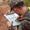 (FORT BENNING, GA) A student uses his protractor and map to determine his location during the Warrior Leader Course, August 20, 2013 at Fort Benning. US Army photo Patrick A. Albright. Students must find a minimum of three of four points to graduate from WLC.
