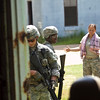 (FORT BENNING, GA) Soldiers question an Imam as about the location of a possible insurgent while other members of the squad provide security during Situational Training Exercise (STX) in the Warrior Leader Course, August 22, 2013 at Fort Benning. US Army photo Patrick A. Albright. Cultural awareness is one of the scenarios presented during this training.