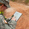 (FORT BENNING, GA) A student checks a her map and compass to determine her location  during the land Navigation phase of the Warrior Leader Course, August 20, 2013 at Fort Benning. US Army photo Patrick A. Albright. Students are given a map, compass and protractor to navigate their way to four locations.
