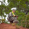 (FORT BENNING, GA) Spc. Clint Massey, 7th Sustainment Brigade, checks his map during the Warrior Leader Course, August 20, 2013 at Fort Benning. US Army photo Patrick A. Albright. Land navigation training prepares the Soldier to move from point A to point B anywhere in the world to accomplish the assigned mission.
