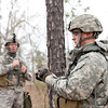 (FORT BENNING, Ga.) Staff Sgt. William Bookout and Spc Jacob Black establish a Field-Expedient Omni-directional Antenna during the Reconnaissance Lane at the Fort Benning and U.S. Army Armor School's Inaugural Gainey Cup Scout Competition, March 3, 2013 at Fort Benning.  Bookout and Black are assigned to the Georgia Army National Guard. (Photo by Ashley Cross/U.S. Army)