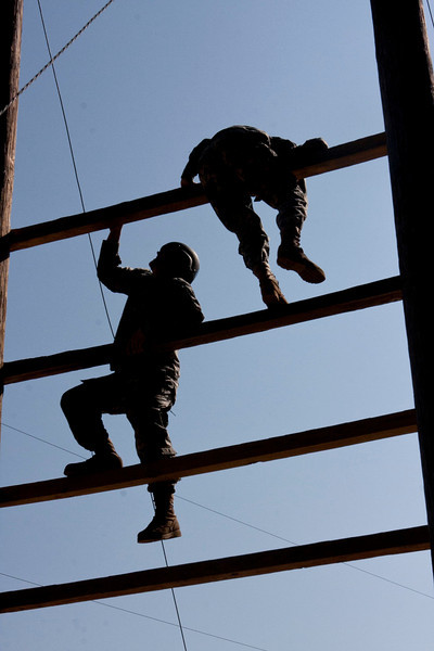 (FORT BENNING,Ga.) The Milwaukee Wisconsin Educator Group tour Sand Hill July 24th, 2012 at Fort Benning,Ga.During the visit the group toured the confidence course,Wilson Village MOUT and watched combatives training. There are about 30,000 soldiers that train at Sand Hill every year.(Photo by Taffy Steinborn Keller/ MCoe PAO Photographer)