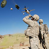 U.S. Army Paratroopers from 1st Battalion (Airborne), 503rd Infantry Regiment, 173rd Airborne Brigade watch as supplies are dropped from an aircraft in the Paktika province of Afghanistan Nov. 10, 2007. (U.S. Army photo by Spc. Micah E. Clare) (Released)