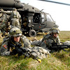 U.S. Soldiers assigned to the 173rd Airborne Brigade Combat Team (ABCT) secure the landing zone at the Joint Multi-National Training Center in Hohenfels, Germany, March 31, 2007. The 173rd ABCT is training for an upcoming deployment to Afghanistan. (U.S. Army photo by Gary L. Kieffer/Released)