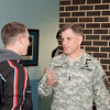 MG Ferriter speaks to a soldier about motorcycle safety