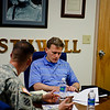 22 MAR 2011 - Author David Baldacci receives a brief before meeting MCCC students and observing VBS2.  MCoE, Fort Benning, GA.  Photo by John D. Helms - john.d.helms@us.army.mil