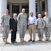 Col. Walter Piatt, retired Lt. Gen. Carmen Cavezza, Maj. Gen. Robert Brown, Secretary of Defense Leon Panetta, Command Sgt. Maj. Steven McClaflin and Thomas James pose for a photo in front of the Follow Me statue at the National Infantry Museum May 4.