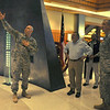 """Sgt. 1st Class Robert Garvey, with the 198th Infantry Brigade, gestures to the Combat Infantryman Badge at the entrance to the """"Last 100 Yards"""" exhibit at the National Infantry Museum May 4.  Garvey was one of the tour guides for Secretary of Defense Leon Panetta's visit."""