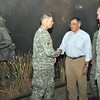 """Secretary of Defense Leon Panetta gives Sgt. 1st Class Travis Larson a coin after Larson's portion of the """"Last 100 Yards"""" guided tour May 4."""