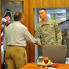 Spc. Andrew Markmann, with 3rd Heavy Brigade Combat Team, receives a coin from Secretary of Defense Leon Panetta May 4 before the group of junior enlisted Soldiers ate lunch with the 23rd secretary of Defense at the National Infantry Museum.