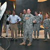 """After talking about the Army Values and Combat Infantryman Badge, Sgt. 1st Class Robert Garvey, with the 198th Infantry Brigade, talks about the Revolutionary War while acting as a tour guide to Secretary of Defense Leon Panetta for the """"Last 100 Yards"""" exhibit at the National Infantry Museum May 4."""