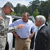 Retired Lt. Gen. Carmen Cavezza greets Maj. Gen. Robert Brown and Secretary of Defense Leon Panetta before they tour the National Infantry Museum May 4,
