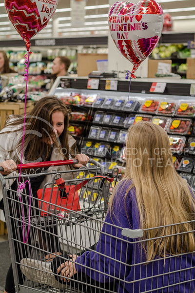 "Rainie Madsen, sophomore in Landscape Architecture, and Kristen Kimbrell, sophomore in Plant Science and Biotechnology, shop for items to make fruit bouquets for ""Galentine's Day"". (Mary Kate Zach 