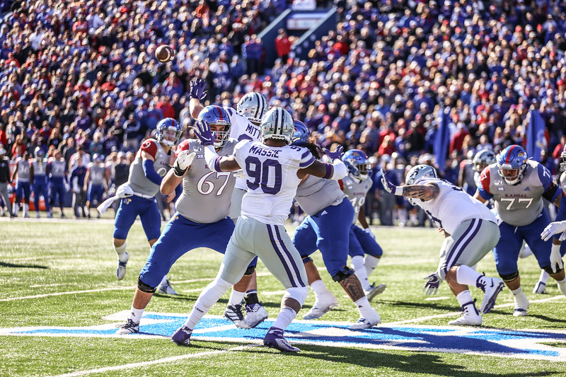 Both K-State and KU fans cheer on their football teams during the K-State vs. KU game in David Booth Memorial Stadium on Nov. 2, 2019. The Wildcats defeated the Jayhawks in this year's sunflower showdown with a final score of 38-10. (Emily Lenk | Collegian Media Group)