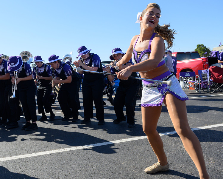 Junior twirler Delaney Madden performs in front of tailgate crowds at Bill Snyder Family Stadium on Oct 19, 2019. The Wildcats defeated the Horned Frogs 24-17. (Dylan Connell | Collegian Media Group)