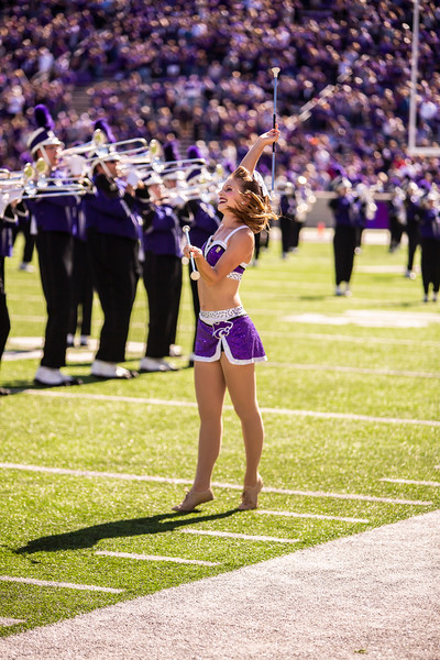 Sophomore twirler Katie Dreiling performs before K-State's football game against TCU at Bill Snyder Family Stadium on Oct. 19, 2019. The Wildcats took the Horned Frogs 24-17. (Logan Wassall | Collegian Media Group)