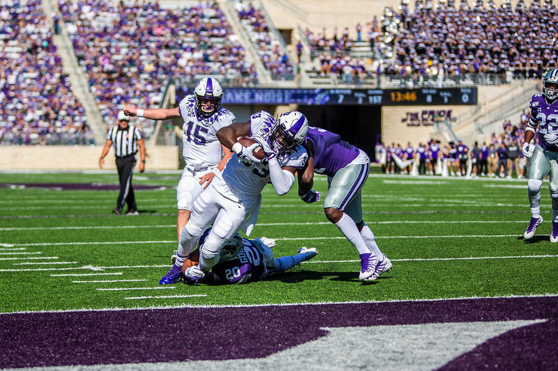 TCU senior running back Sewo Olonilua scores a touchdown during their football game against K-State at Bill Snyder Family Stadium on Oct. 19, 2019. The Wildcats took the Horned Frogs 24-17. (Logan Wassall | Collegian Media Group)