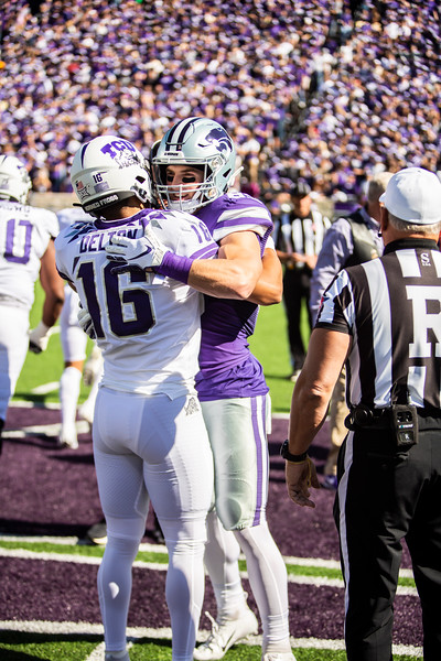 Senior wide receiver Dalton Schoen embraces former K-State quarterback Alex Delton after the coin toss before K-State's game against TCU at Bill Snyder Family Stadium on Oct. 19, 2019. The Wildcats took the Horned Frogs 24-17. (Logan Wassall | Collegian Media Group)