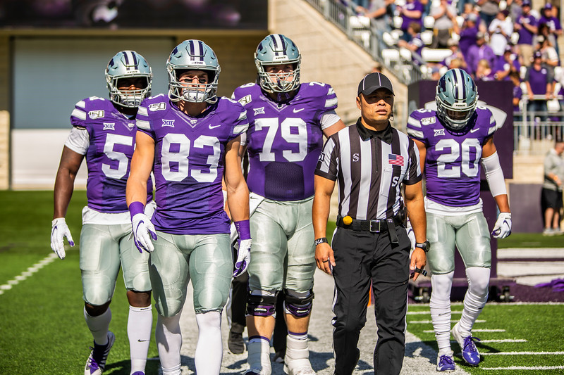 K-State's team captains walk out on the field to prepare for the coin toss before their game against TCU at Bill Snyder Family Stadium on Oct. 19, 2019. The Wildcats took the Horned Frogs 24-17. (Logan Wassall | Collegian Media Group)