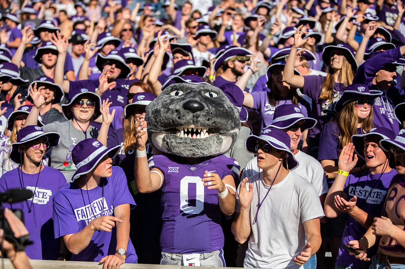 Willie Wildcat leads K-State fans in cheering on their football team during their game against TCU at Bill Snyder Family Stadium on Oct. 19, 2019. The Wildcats took the Horned Frogs 24-17. (Logan Wassall | Collegian Media Group)