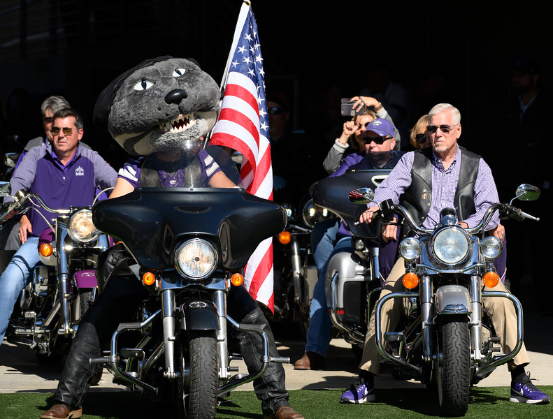 Willie Wildcat and President Richard B. Myers prepare to ride around the KSU stadium for Harley Day, pregame against TCU at Bill Snyder Family Stadium on Oct 19, 2019. The Wildcats defeated the Horned Frogs 24-17. (Dylan Connell | Collegian Media Group)