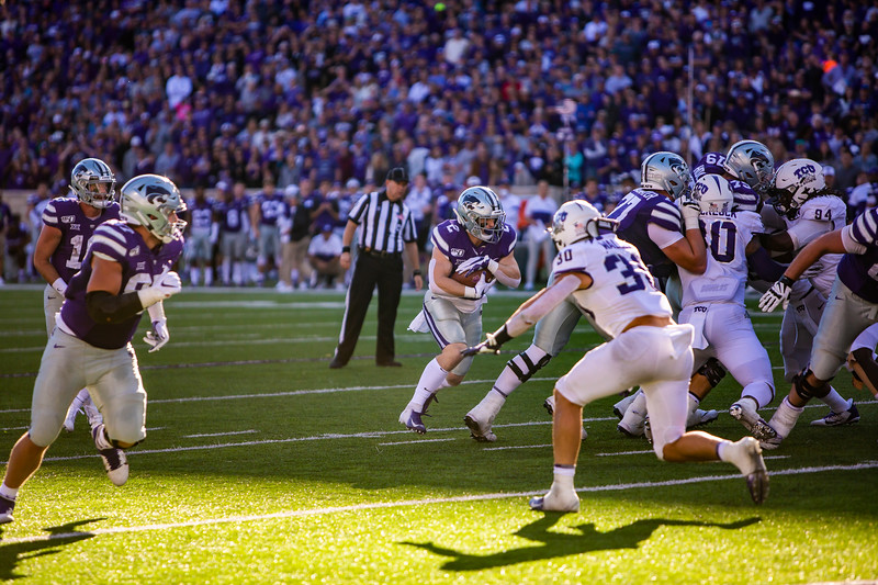 Junior running back Harry Trotter runs the ball during K-State's football game against TCU at Bill Snyder Family Stadium on Oct. 19, 2019. The Wildcats took the Horned Frogs 24-17. (Logan Wassall | Collegian Media Group)