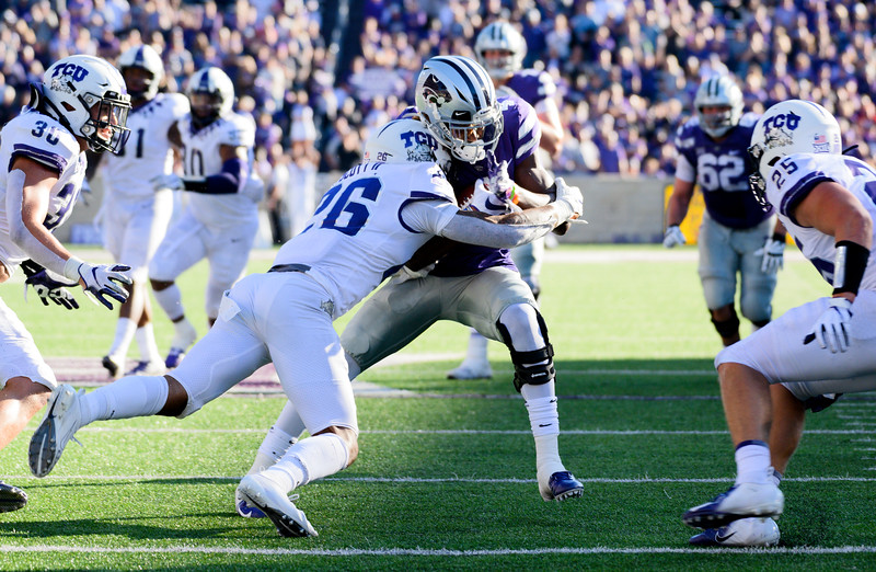K-State wide receiver, Malik Knowles, is defended by TCU Safety Vernon Scott after catching a pass. KSU and TCU faced off at Bill Snyder Family Stadium on Oct 19, 2019. The Wildcats defeated the Horned Frogs 24-17. (Dylan Connell | Collegian Media Group)