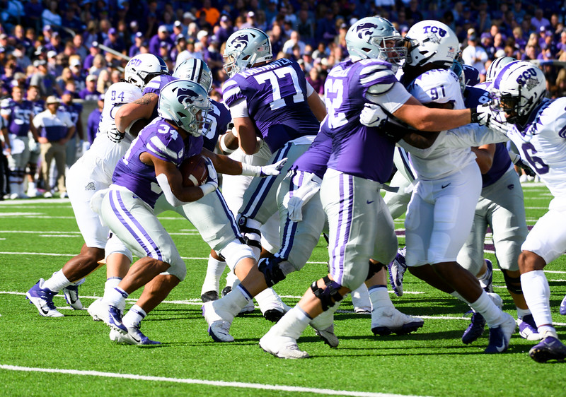 KSU Running Back, James Gilbert, searches for a gap that the offensive line provides against TCU. KSU and TCU faced off at Bill Snyder Family Stadium on Oct 19, 2019. The Wildcats defeated the Horned Frogs 24-17. (Dylan Connell | Collegian Media Group)