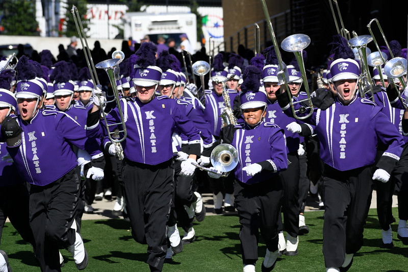 Marching band members storm the field to perform their pregame show at Bill Snyder Family Stadium on Oct 19, 2019. The Wildcats defeated the Horned Frogs 24-17. (Dylan Connell | Collegian Media Group)