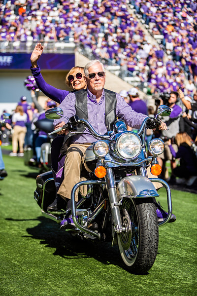 President Richard B. Myers rides his motorcycle around the field in honor of Harley Day before K-State's football game against TCU at Bill Snyder Family Stadium on Oct. 19, 2019. The Wildcats took the Horned Frogs 24-17. (Logan Wassall | Collegian Media Group)