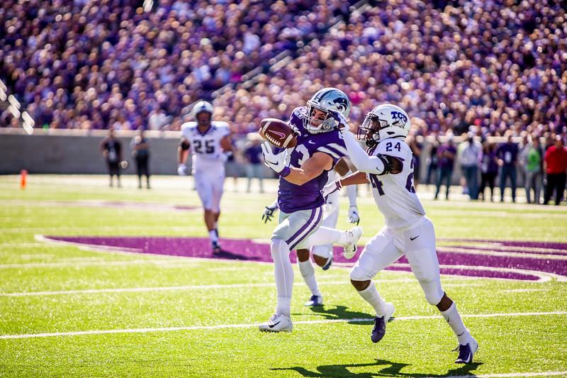 Senior wide receiver Dalton Schoen leaps up for a catch during K-State's football game against TCU at Bill Snyder Family Stadium on Oct. 19, 2019. The Wildcats took the Horned Frogs 24-17. (Logan Wassall | Collegian Media Group)