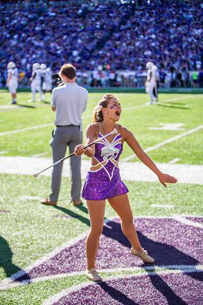 Junior twirler Delaney Madden performs during K-State's football game against TCU at Bill Snyder Family Stadium on Oct. 19, 2019. The Wildcats took the Horned Frogs 24-17. (Logan Wassall | Collegian Media Group)