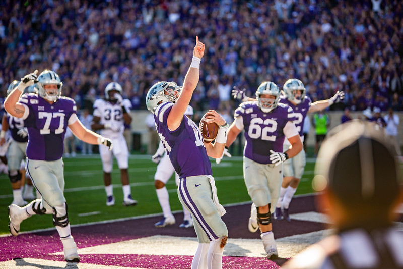 Junior quarterback Skylar Thompson celebrates with his teammates after running in a touchdown during K-State's football game against TCU at Bill Snyder Family Stadium on Oct. 19, 2019. The Wildcats took the Horned Frogs 24-17. (Logan Wassall | Collegian Media Group)