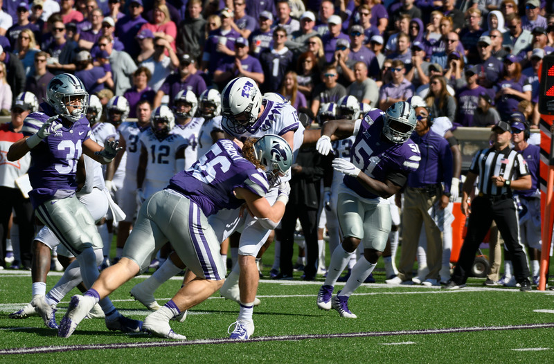 Defensive End, Wyatt Hubert, tackles the TCU Quarterback, Max Duggan, as he attempts a throw. KSU and TCU faced off at Bill Snyder Family Stadium on Oct 19, 2019. The Wildcats defeated the Horned Frogs 24-17. (Dylan Connell | Collegian Media Group)
