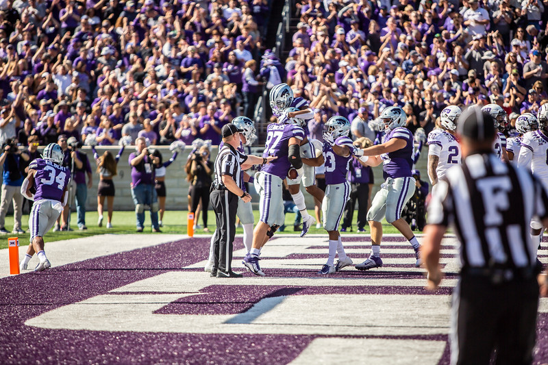 K-State's football team celebrates after scoring a touchdown during their game against TCU at Bill Snyder Family Stadium on Oct. 19, 2019. The Wildcats took the Horned Frogs 24-17. (Logan Wassall | Collegian Media Group)