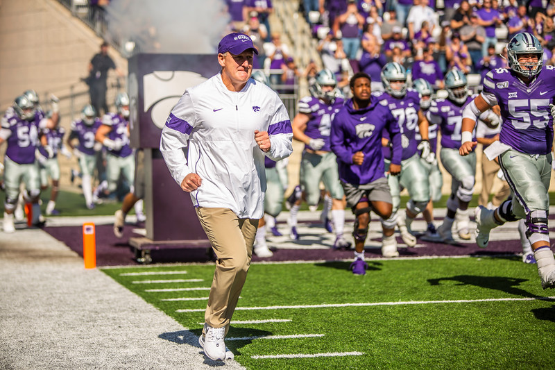 K-State head coach Chris Klieman runs out onto the field with the rest of the team before the foottball game against TCU at Bill Snyder Family Stadium on Oct. 19, 2019. The Wildcats took the Horned Frogs 24-17. (Logan Wassall | Collegian Media Group)