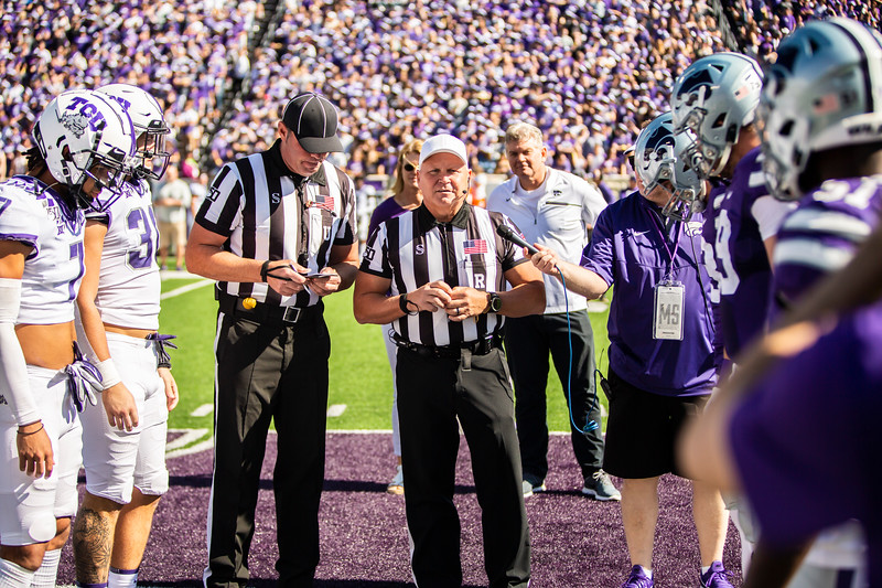 K-State and TCU team captains meet at midfield for the coin toss before their game at Bill Snyder Family Stadium on Oct. 19, 2019. The Wildcats took the Horned Frogs 24-17. (Logan Wassall | Collegian Media Group)