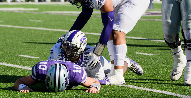 TCU safety, Innis Gaines, tackles KSU QB, Skylar Thompson, on his blind-side while throwing the ball.KSU and TCU faced off at Bill Snyder Family Stadium on Oct 19, 2019. The Wildcats defeated the Horned Frogs 24-17. (Dylan Connell | Collegian Media Group)