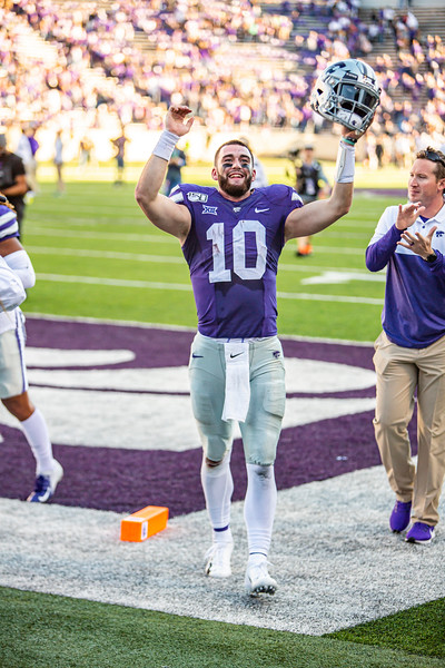 Junior quarterback Skylar Thompson celebrates while running off the field after winning their football game against TCU at Bill Snyder Family Stadium on Oct. 19, 2019. The Wildcats took the Horned Frogs 24-17. (Logan Wassall | Collegian Media Group)