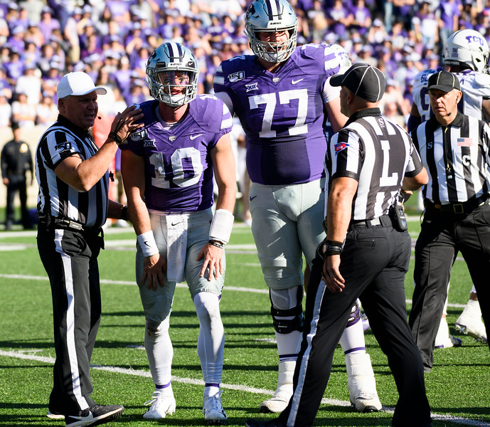 KSU QB, Skylar Thompson, grimaces in pain after being tackled by TCU safety, Innis Gaines.KSU and TCU faced off at Bill Snyder Family Stadium on Oct 19, 2019. The Wildcats defeated the Horned Frogs 24-17. (Dylan Connell | Collegian Media Group)