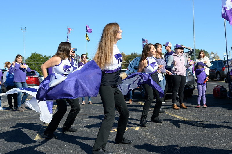 Cheerleaders, twirlers, color-guard and marching band members play for tailgaters at Bill Snyder Family Stadium on Oct 19, 2019. The Wildcats defeated the Horned Frogs 24-17. (Dylan Connell | Collegian Media Group)