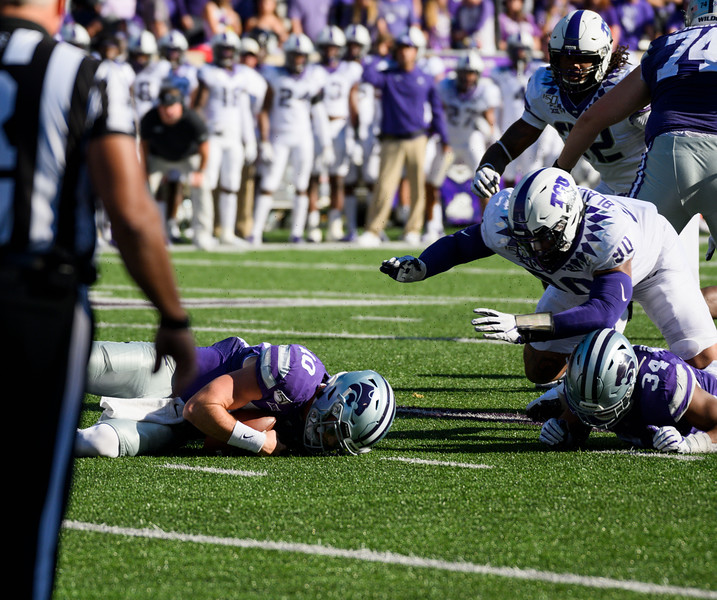 QB, Skylar Thompson, fumbles the ball after mishandling the snapped ball against TCU. Skylar Thompson recovered the ball. KSU and TCU faced off at Bill Snyder Family Stadium on Oct 19, 2019. The Wildcats defeated the Horned Frogs 24-17. (Dylan Connell | Collegian Media Group)