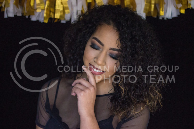 Isabelle McCoy shows the final look of the New Years Eve makeup tutorial on November 10th, 2017. ( Kelly Pham   Collegian Media Group)